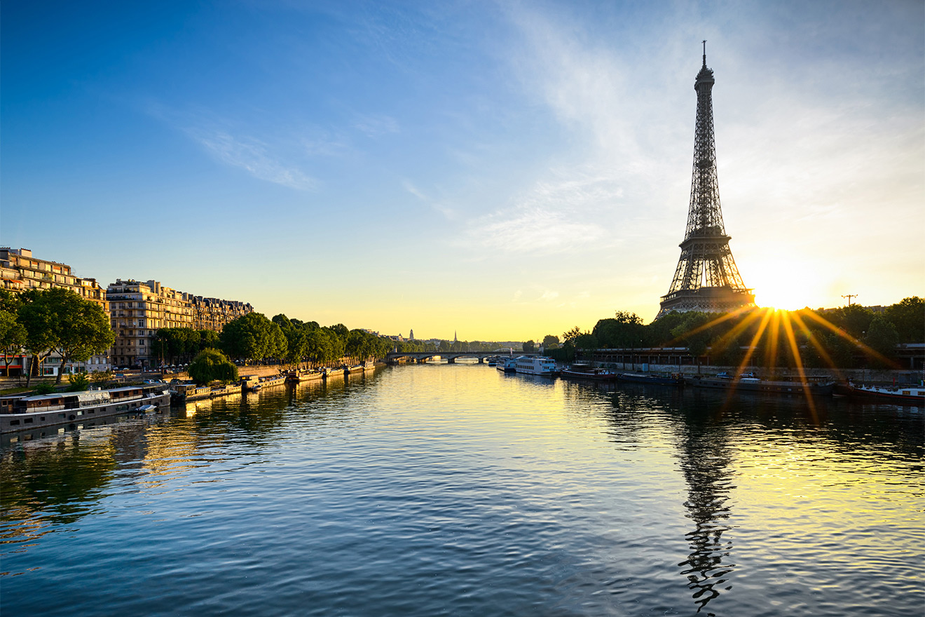 Watch the sun set over the Seine River