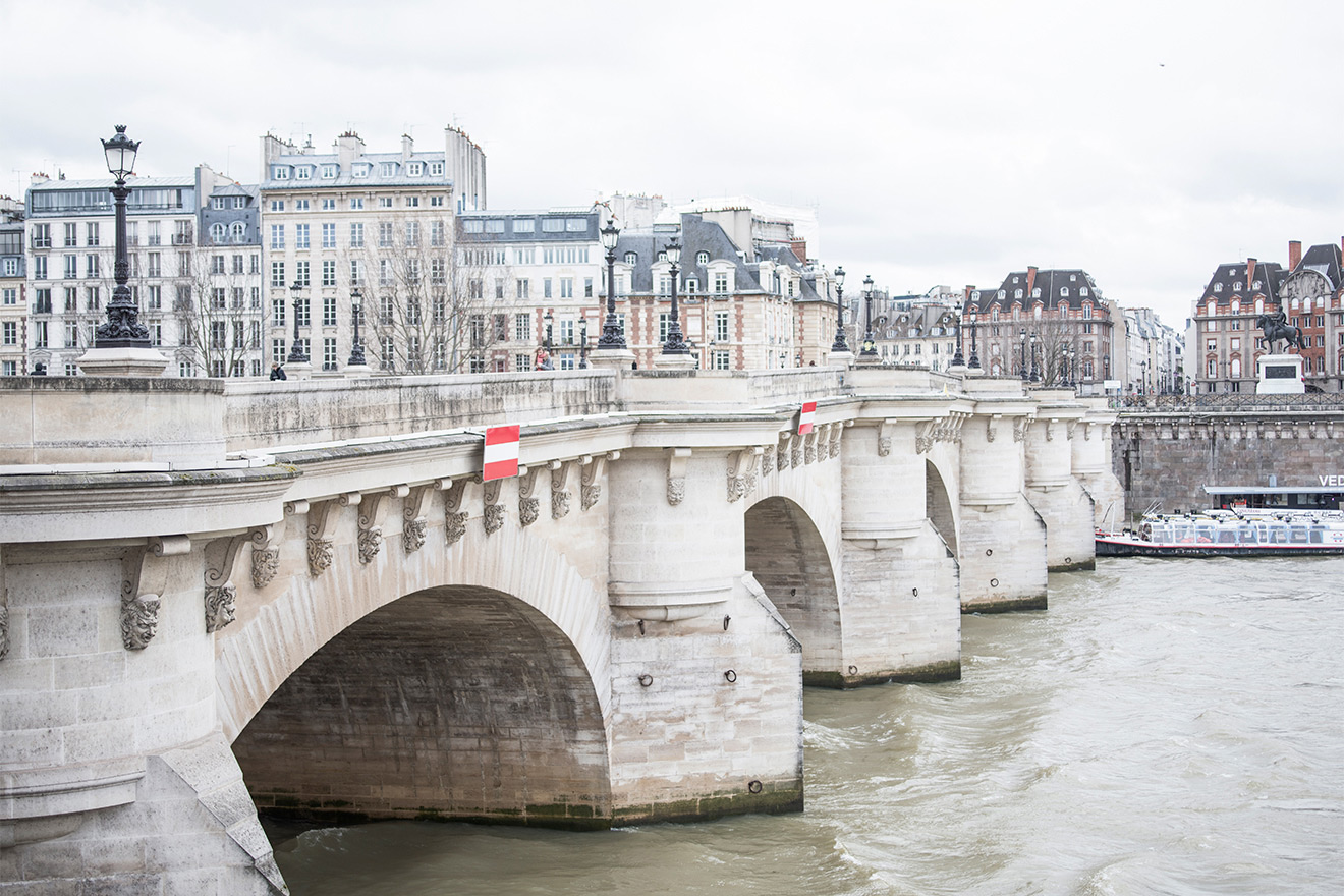 Enjoy a scenic walk along the Seine River to Paris sights and shopping