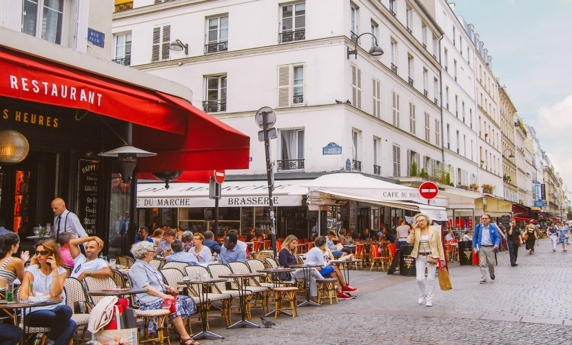 Relax at a local cafe and watch how life happens on rue Cler street market