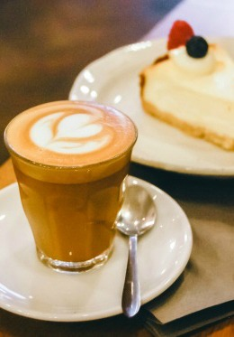 Enjoy a break with cappucino and cake at the Cafe next door