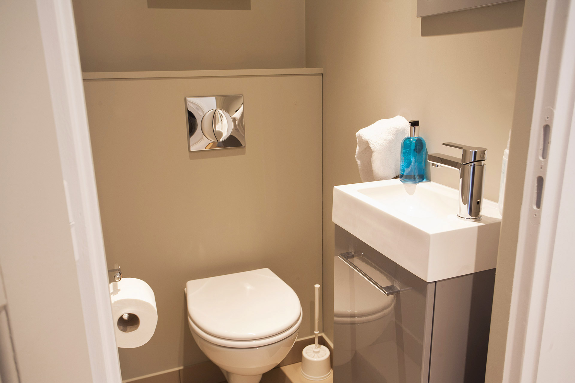 Separate half bath with toilet and basin