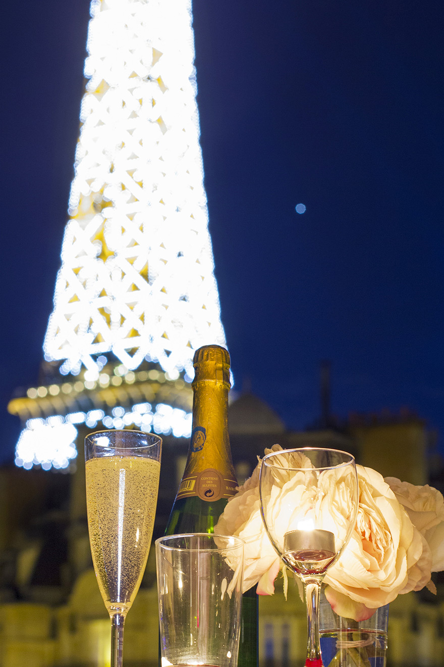 Champagne and an Eiffel Tower view at night from the Champagne vacation rental offered by Paris Perfect