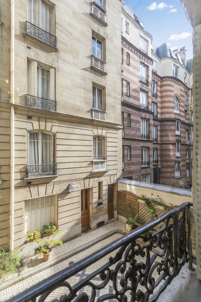 Enjoy the beautiful neighborhood's Haussmannian architecture in the Roannaise vacation rental by Paris Perfect