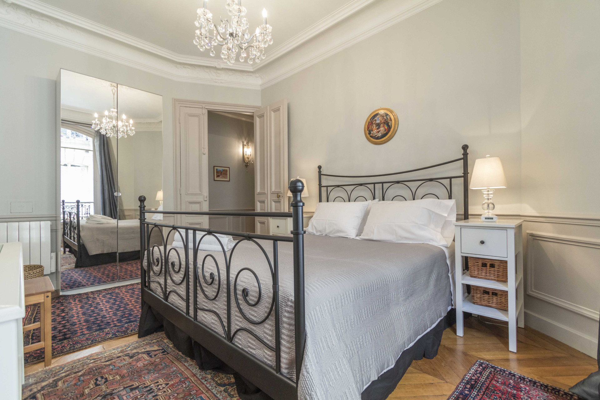 Spacious bedroom area perfect to spend your nights in Paris in the Roannaise vacation rental by Paris Perfect