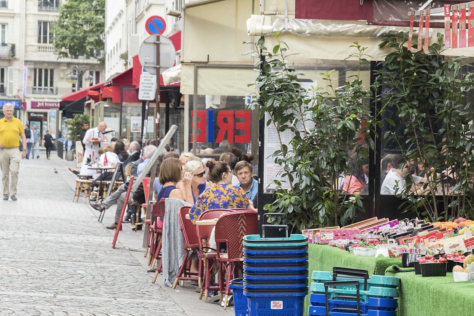Cafés and marchés abound in the neighborhood in the Roannaise vacation rental by Paris Perfect