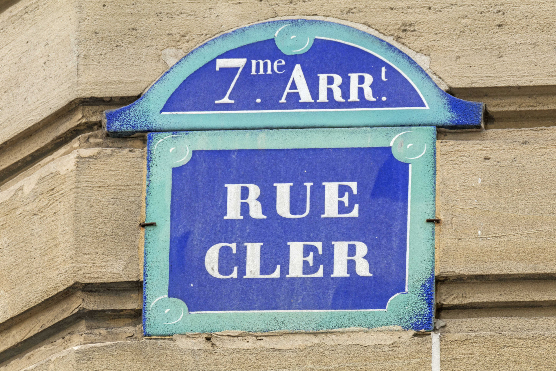 The famous, beautiful Rue Cler right outside your door in the Roannaise vacation rental by Paris Perfect