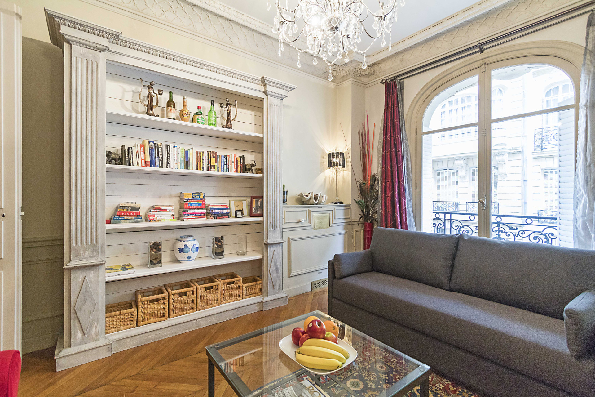 The apartment is furnished with beautiful antique pieces in the Roannaise vacation rental by Paris Perfect