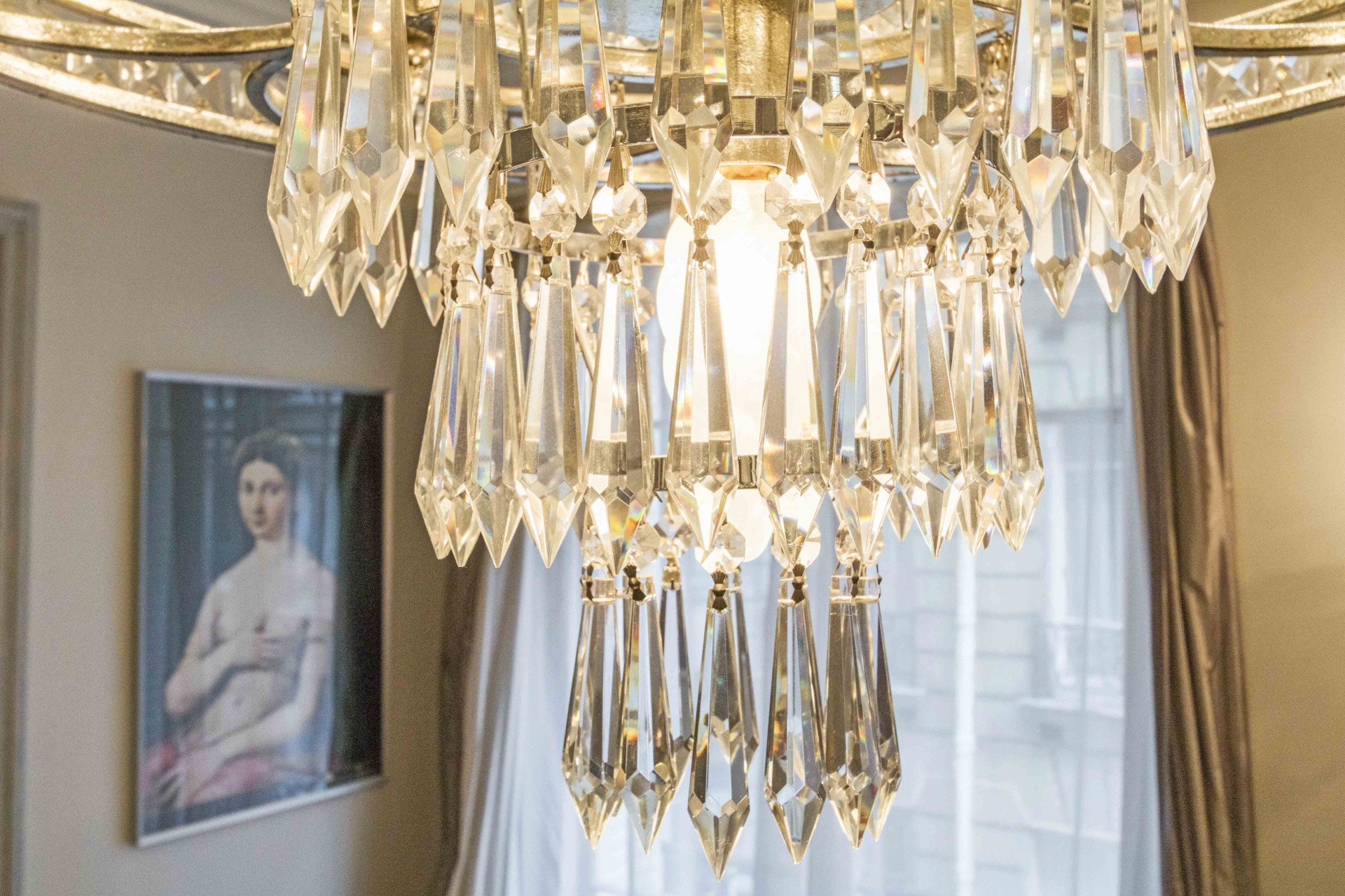 Gorgeous chandelier right above the dining table in the Roannaise vacation rental by Paris Perfect