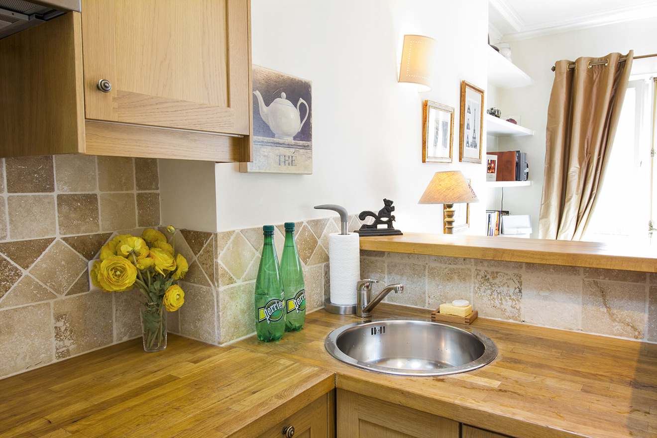 Cleverly designed kitchen to maximize space in the Chablis vacation rental offered by Paris Perfect