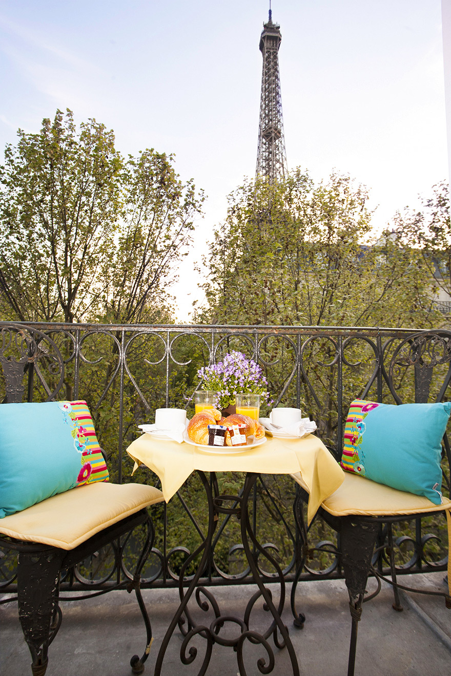 Breakfast on the balcony with Eiffel Tower view in the Chambertin vacation rental offered by Paris Perfect