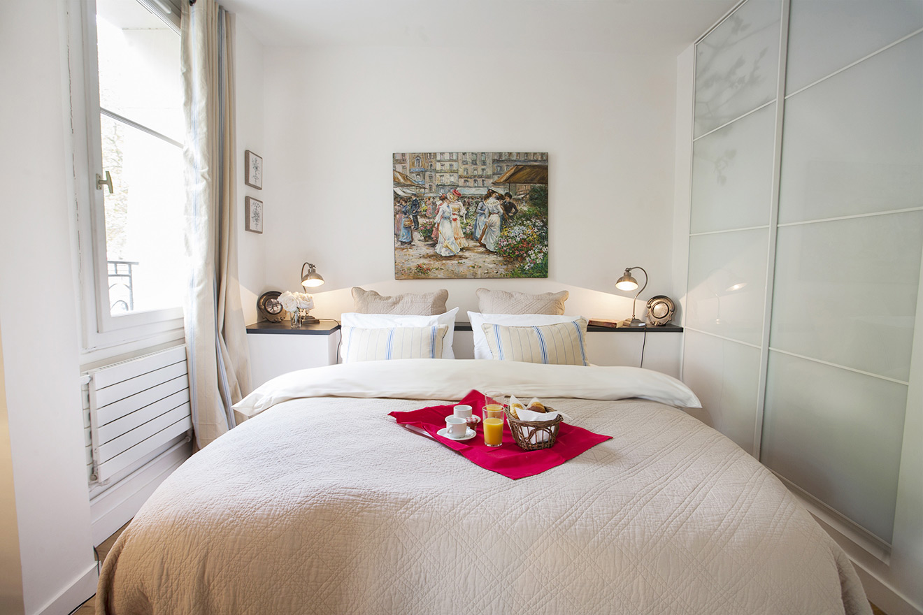 Closet located to right of the queen bed in Paris bedroom