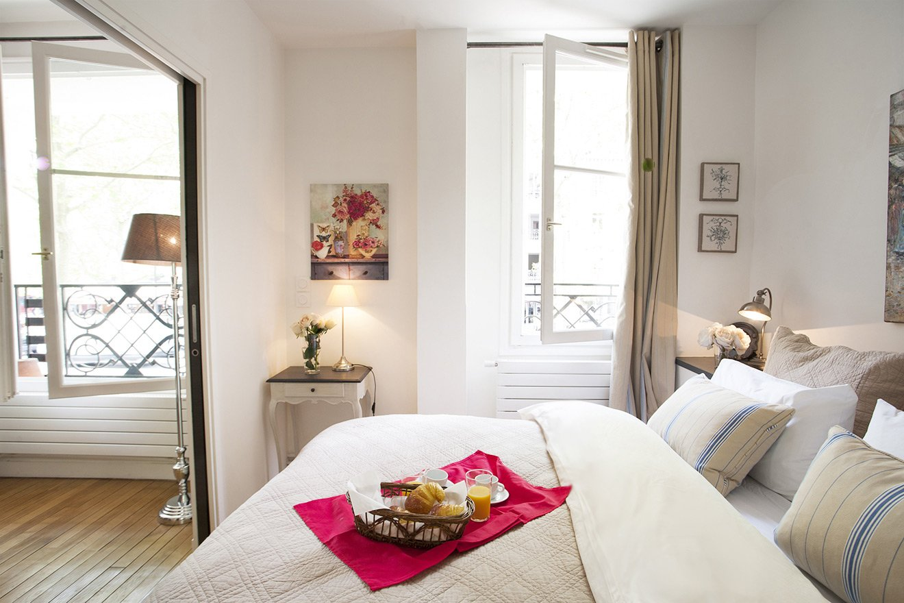Charming bedroom with queen bed and view of Eiffel Tower