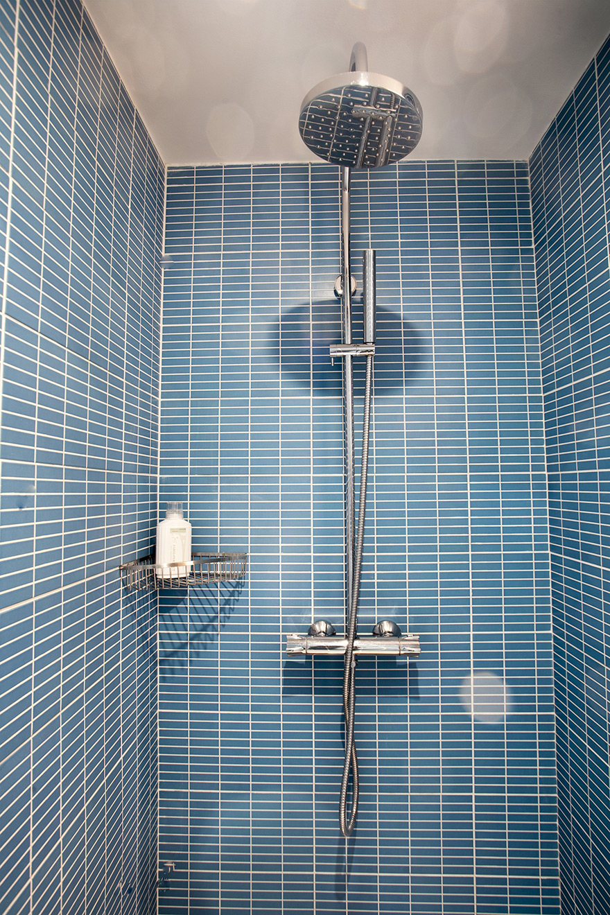 Both flexible and rainwater showerheads in bathroom