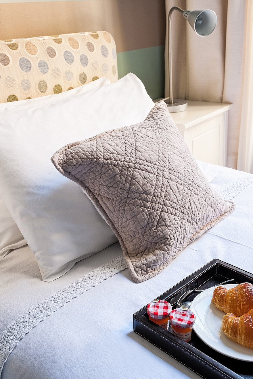 Soft pillows add extra comfort to the beds in the Mâcon vacation rental offered by Paris Perfect