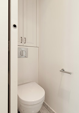 The toilet is stationed in its own separate space in the Montagny vacation rental
