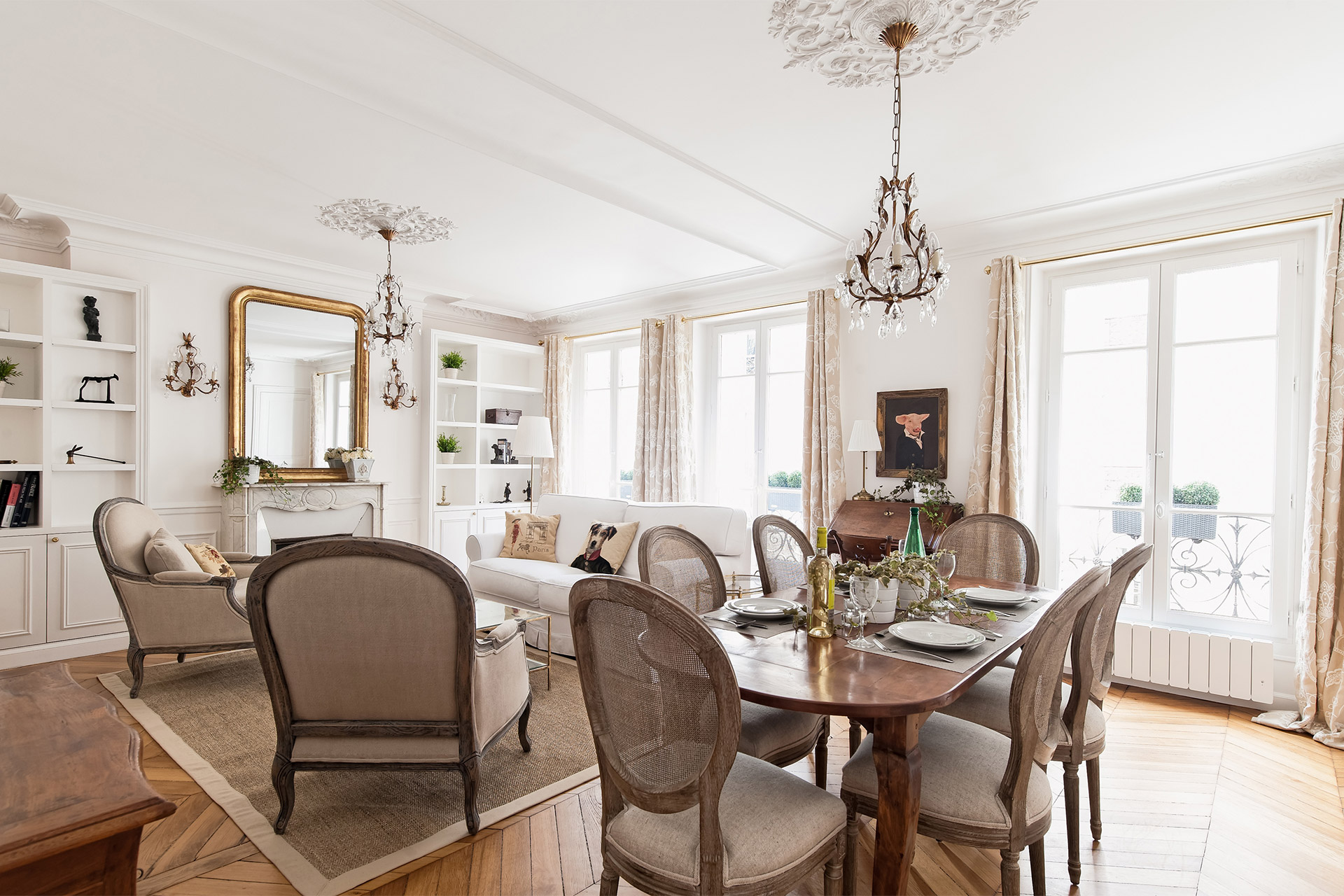 Wooden furnishings and crystal chandeliers in the Montagny vacation rental offered by Paris Perfect