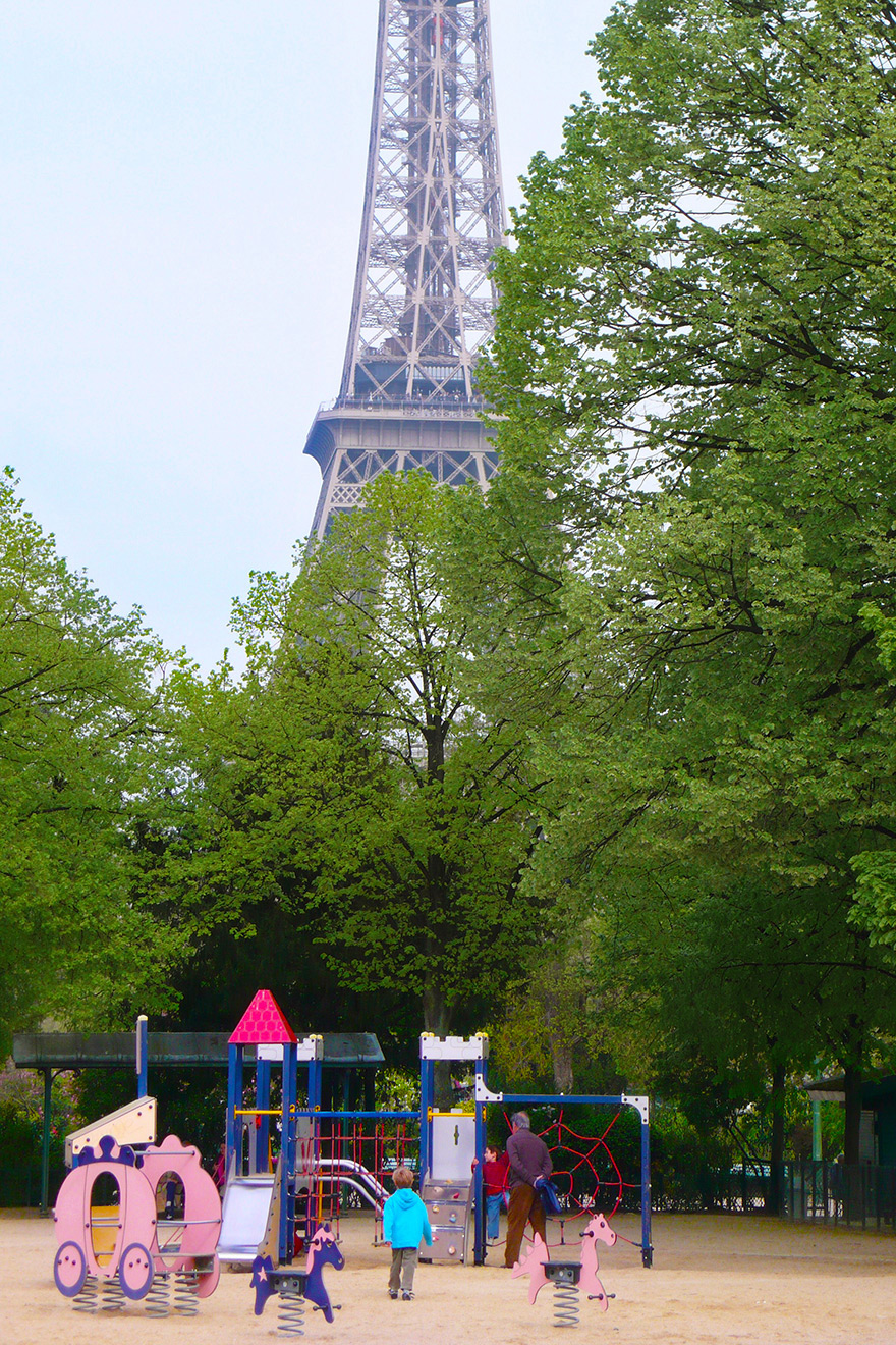 Kids having fun at the playgrounds in the nearby Champ de Mars
