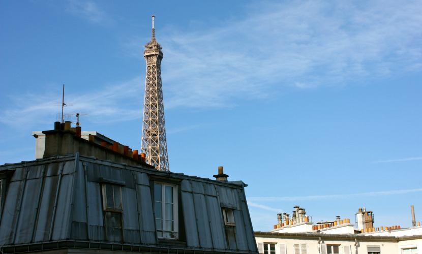 Gorgeous view across the rooftops to the Eiffel Tower at the Chateauneuf vacation rental offered by Paris Perfect