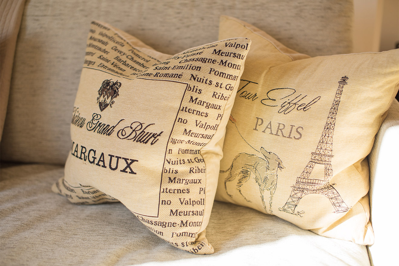 French inspired cushions in the living room of the Cabernet vacation rental offered by Paris Perfect