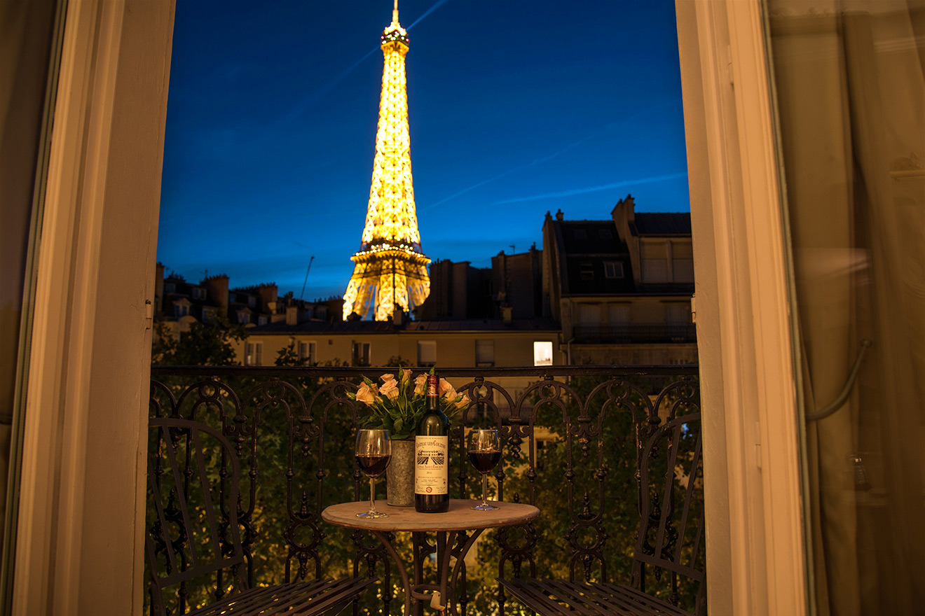 Stunning evening view of the Eiffel Tower from the Cabernet vacation rental offered by Paris Perfect