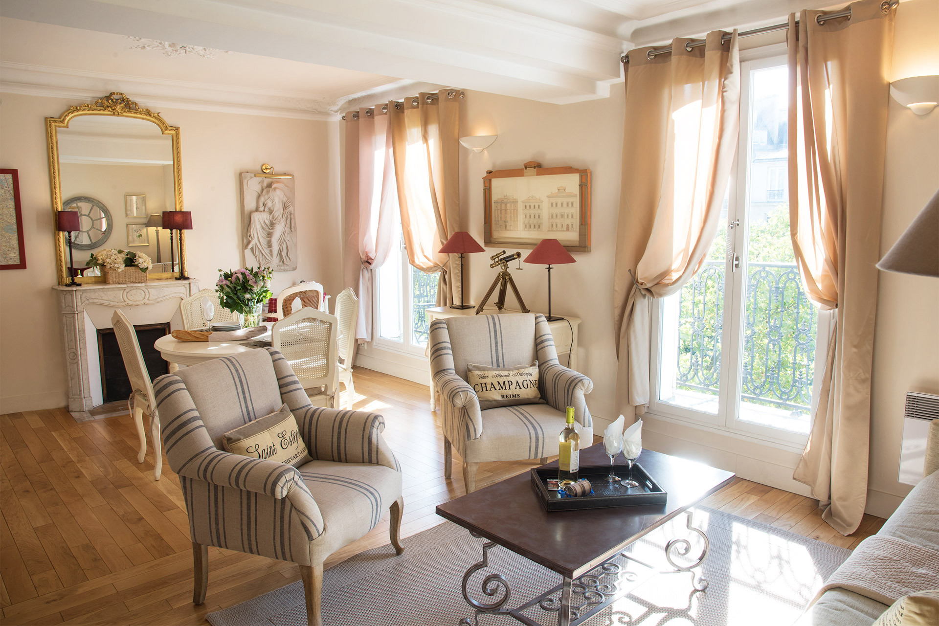 Sunny living and dining area of the Cabernet vacation rental offered by Paris Perfect