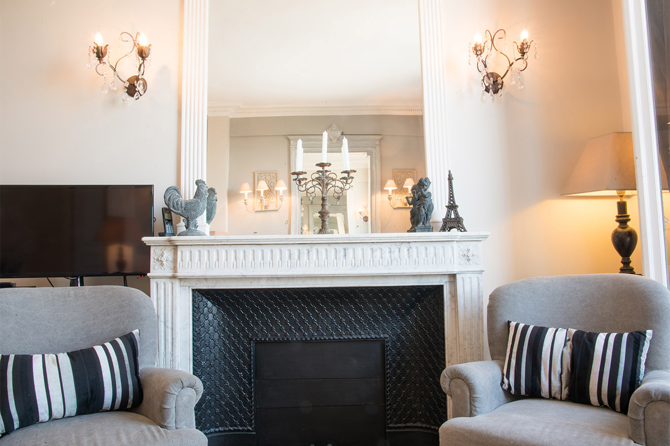 Ample seating in the living room of the Chateau Latour vacation rental by Paris Perfect