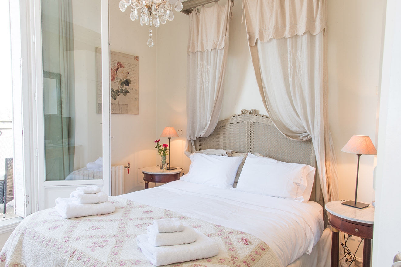 Provencal-style master bedroom of the Chateau Latour vacation rental offered by Paris Perfect