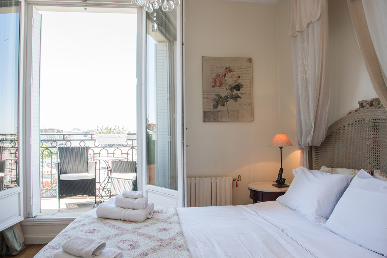 Large French windows in the Chateau Latour vacation rental by Paris Perfect