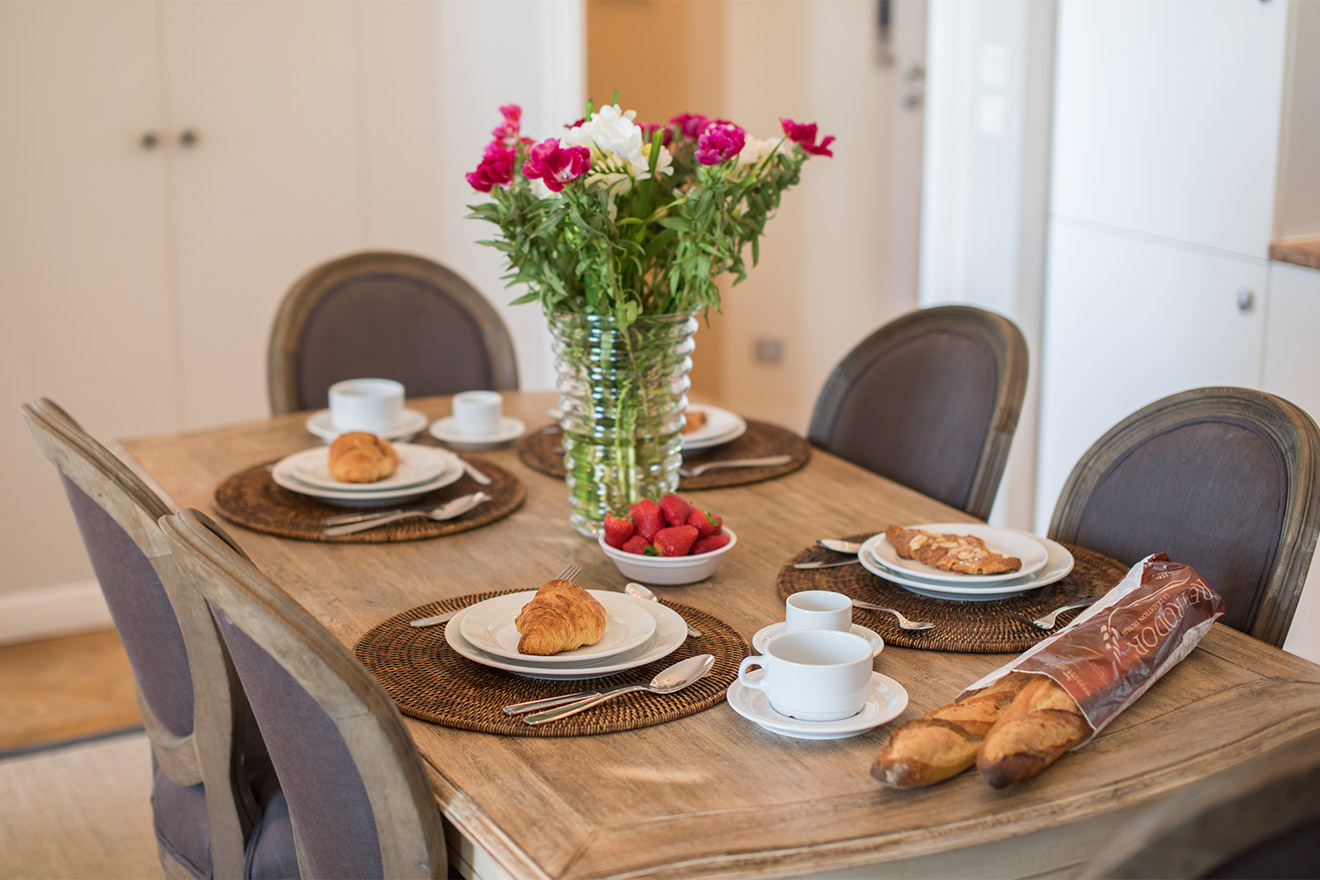 Dining table for six in the Chateau Latour vacation rental by Paris Perfect