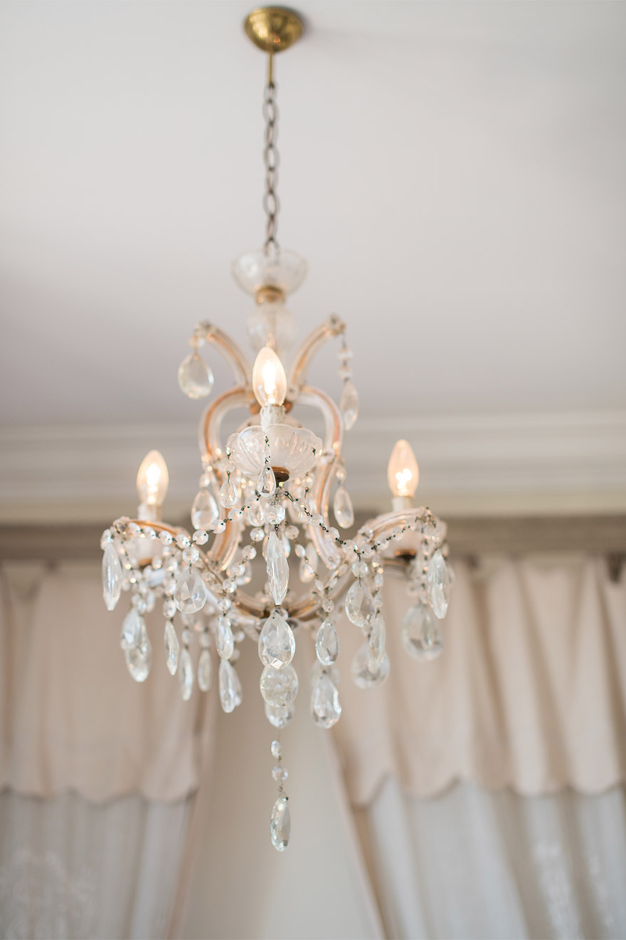 Stunning chandelier in the master bedroom of the Chateau Latour vacation rental offered by Paris Perfect