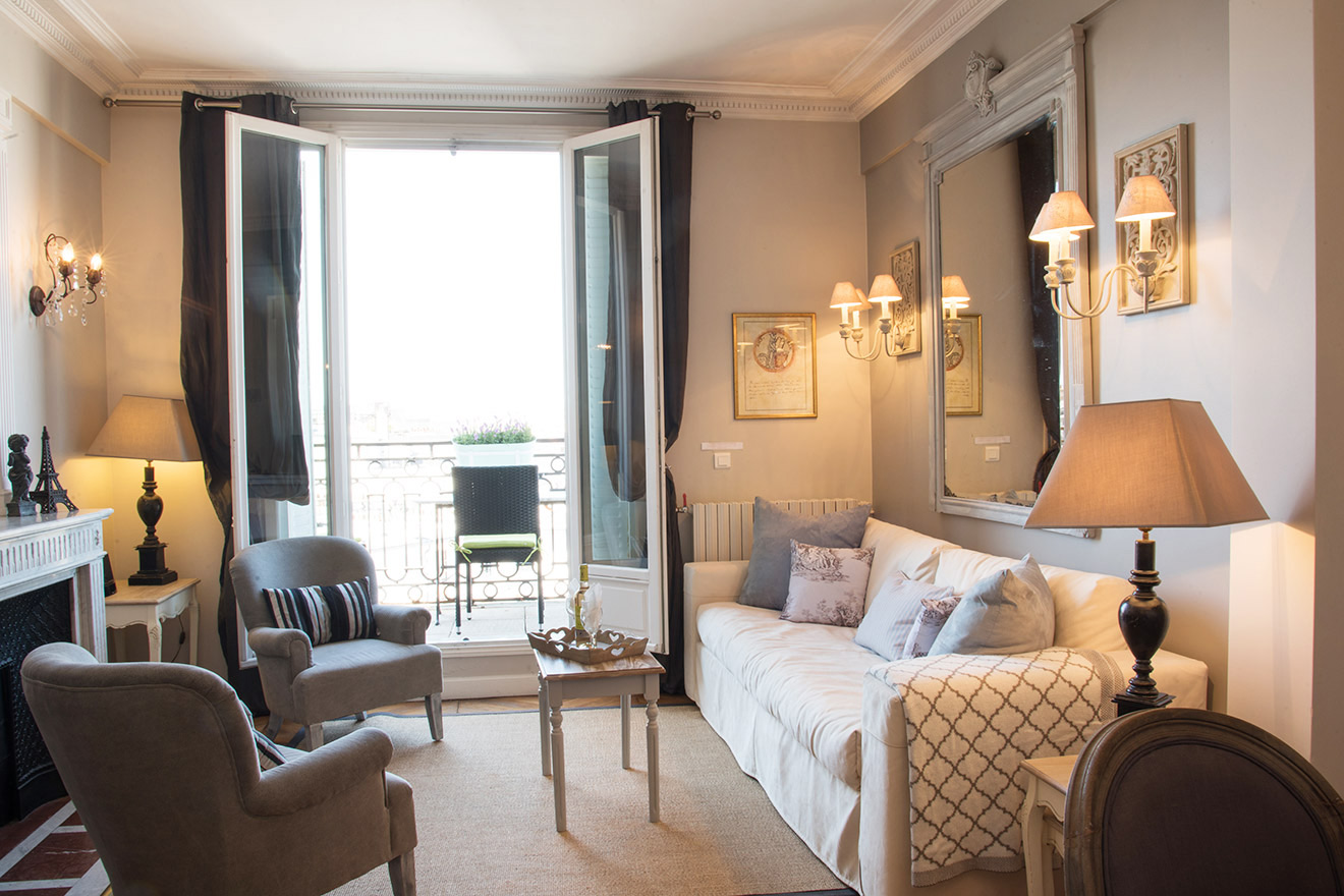 Elegant living room with balcony in the Chateau Latour vacation rental by Paris Perfect