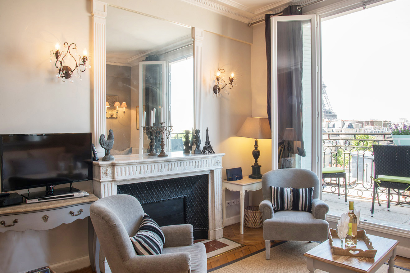 Marble fireplace in the living room of the Chateau Latour vacation rental by Paris Perfect
