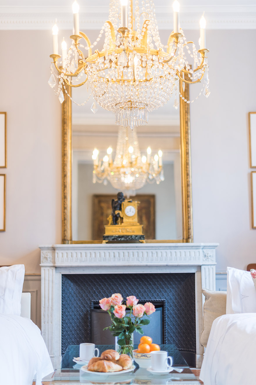 Elegant chandelier hangs over the living room of the Mâcon vacation rental offered by Paris Perfect