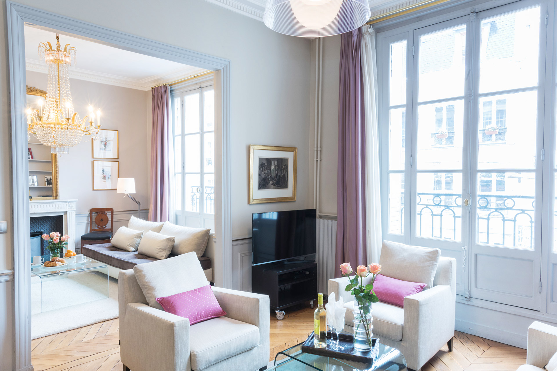 Watch movies on your flat-screen television in the Mâcon vacation rental offered by Paris Perfect