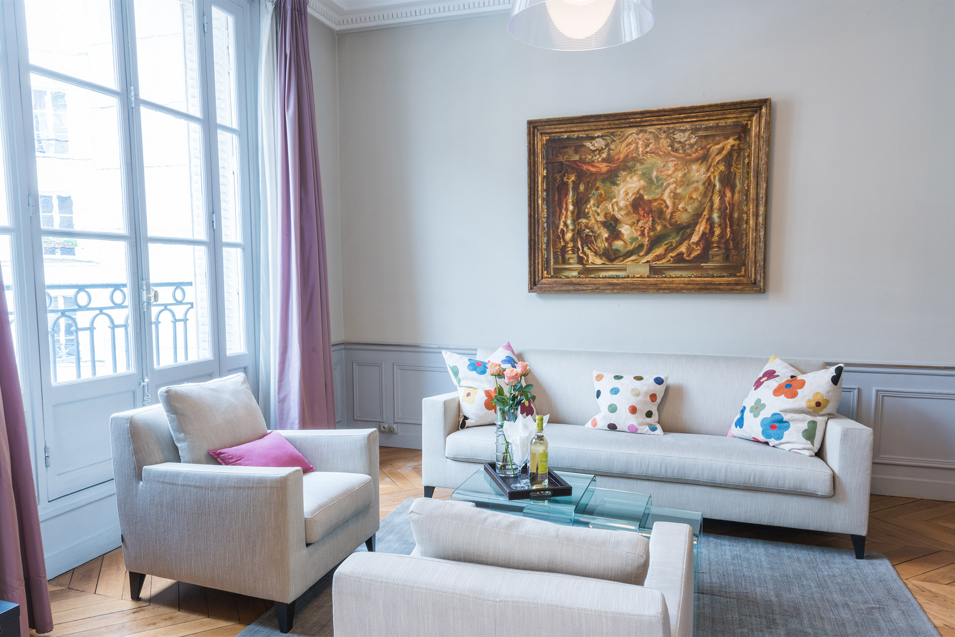 Sunlight streams through the large French windows in the Mâcon vacation rental offered by Paris Perfect