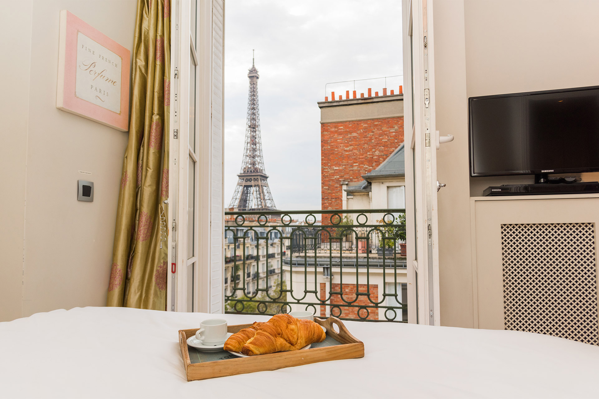 View of the Eiffel Tower from the bed in the Margaux vacation rental offered by Paris Perfect
