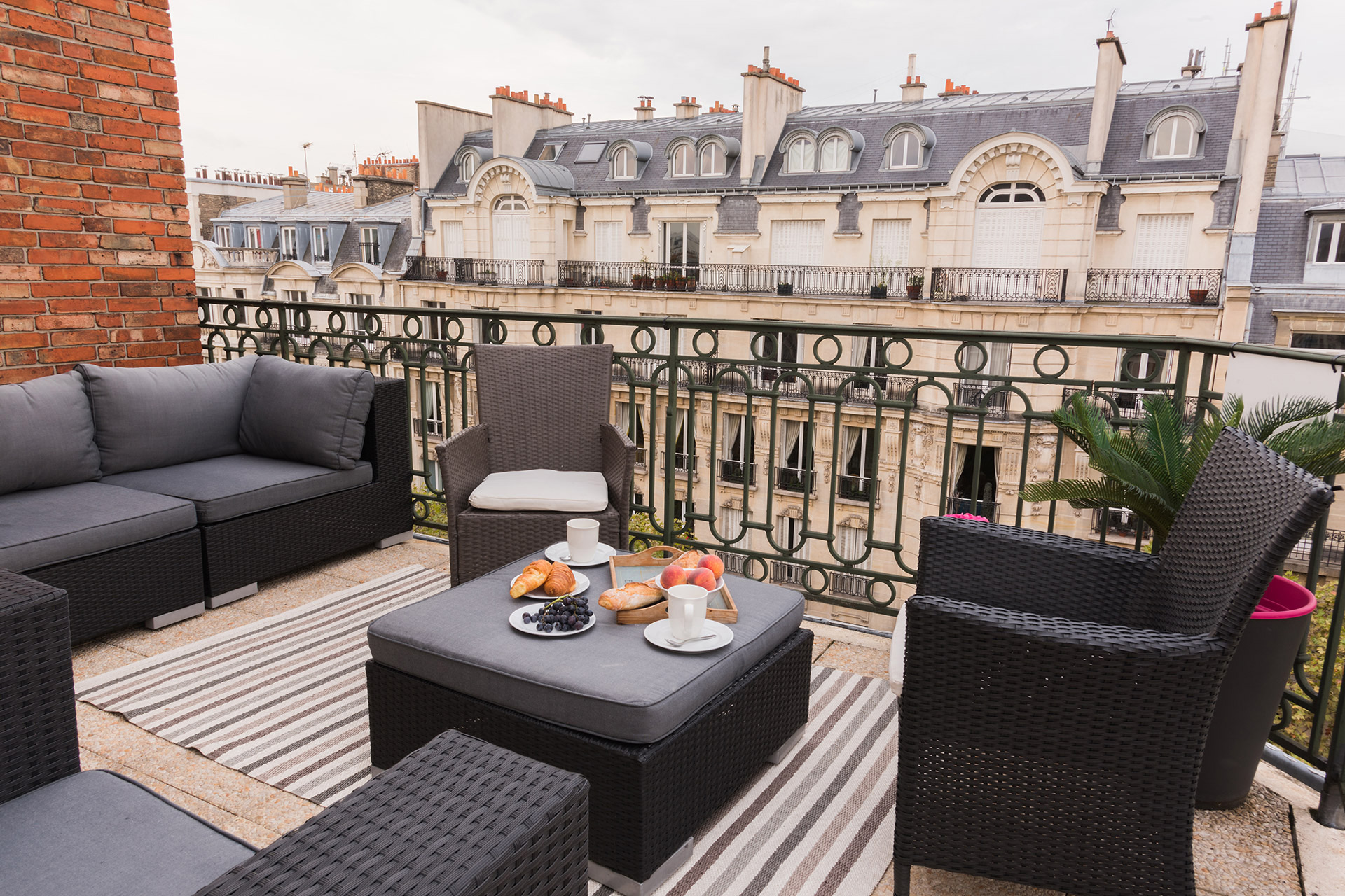 Seating for the whole family on the balcony of the Margaux vacation rental offered by Paris Perfect