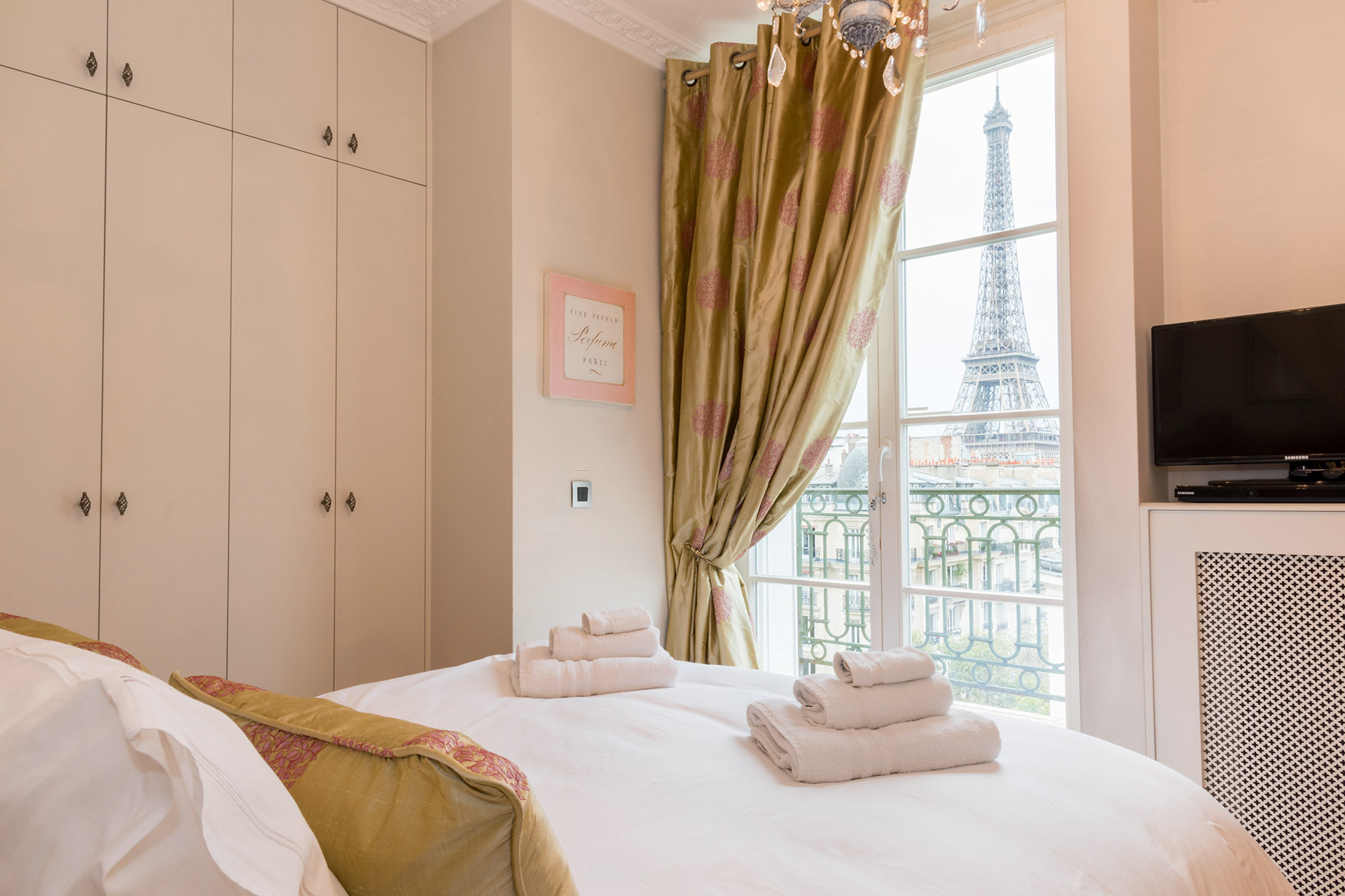 The most romantic bedroom in Paris in the Margaux vacation rental offered by Paris Perfect