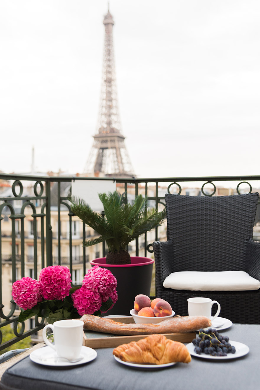 Breakfast out on the balcony of the Margaux vacation rental offered by Paris Perfect