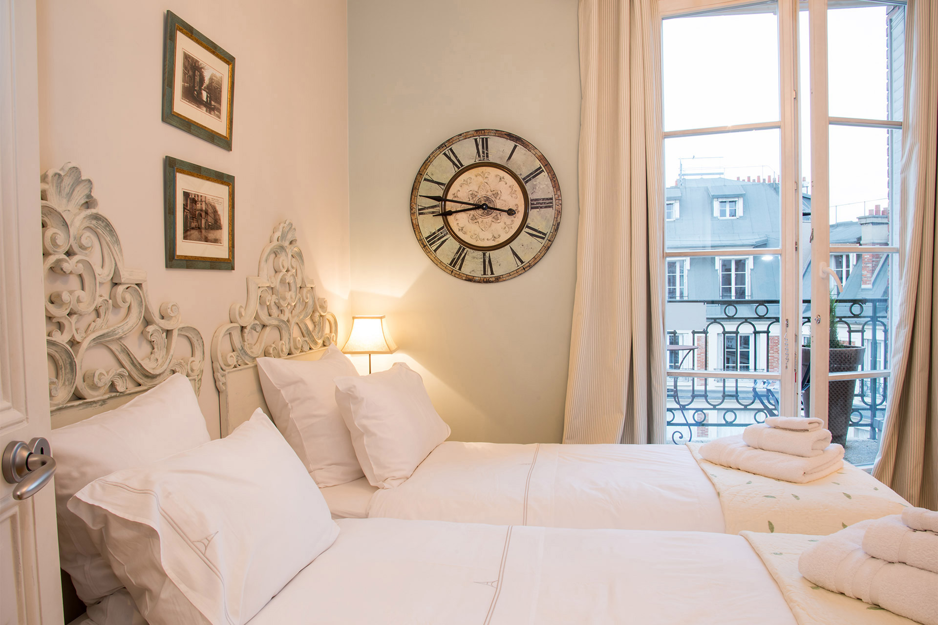 Sunshine streams into the third bedroom of the Margaux vacation rental offered by Paris Perfect