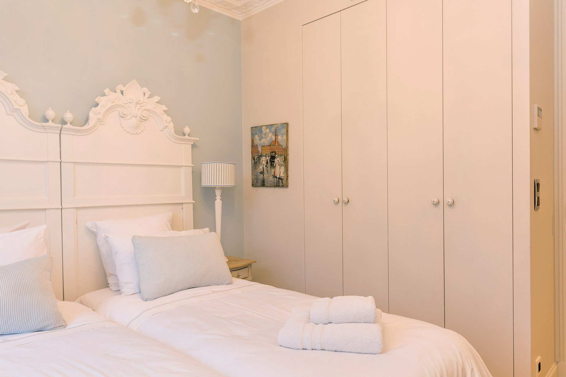 Large built in closets in the second bedroom of the Margaux vacation rental offered by Paris Perfect