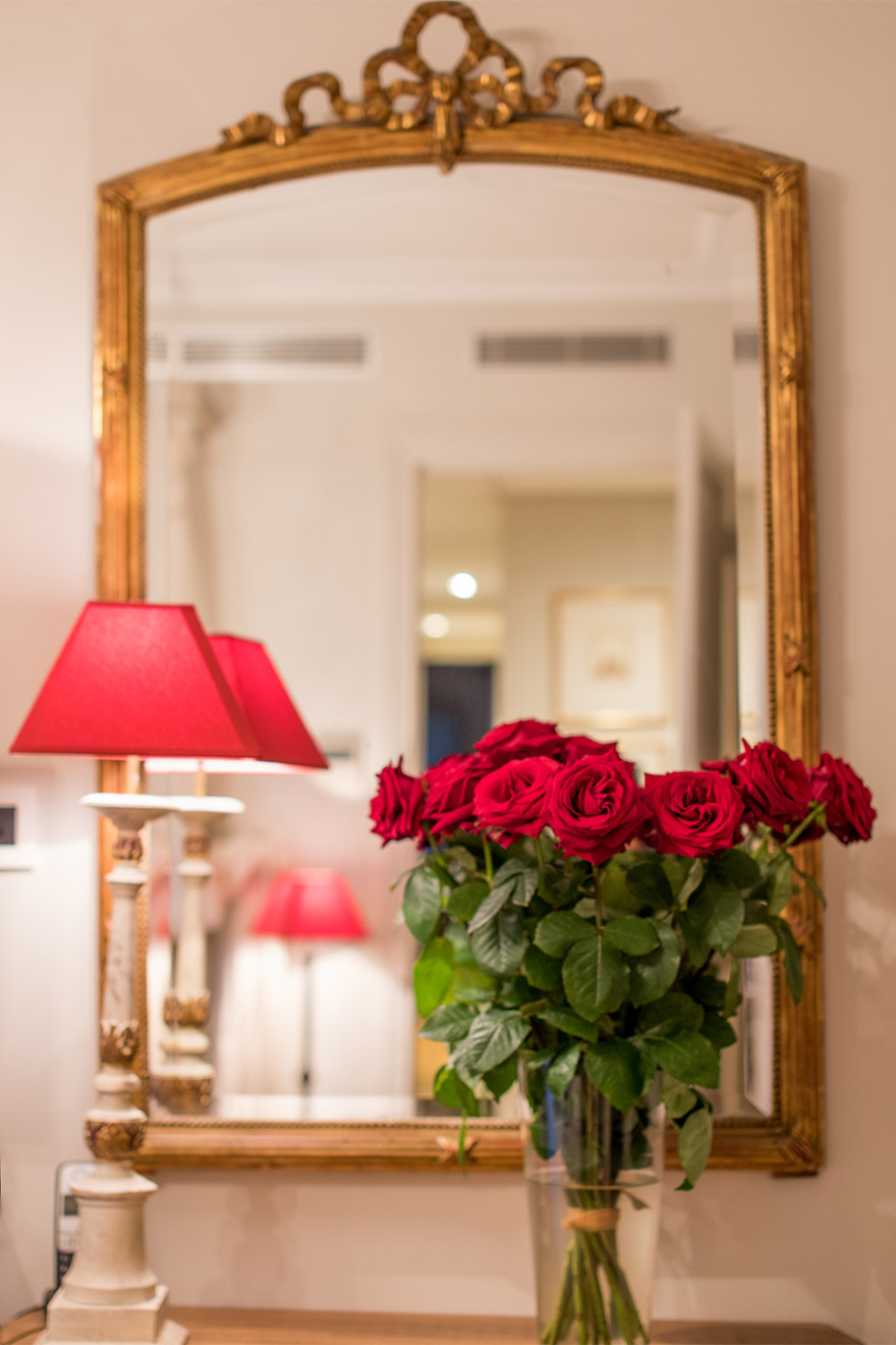 Antique gold mirror in the Margaux vacation rental offered by Paris Perfect