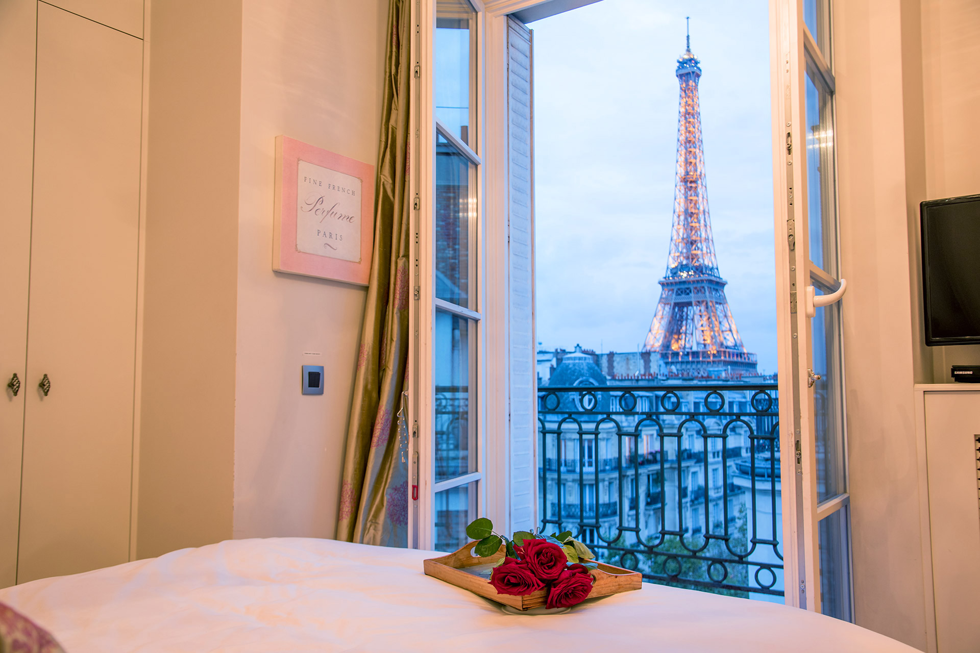 Watch the sunset and the Eiffel Tower light up at the Margaux vacation rental offered by Paris Perfect