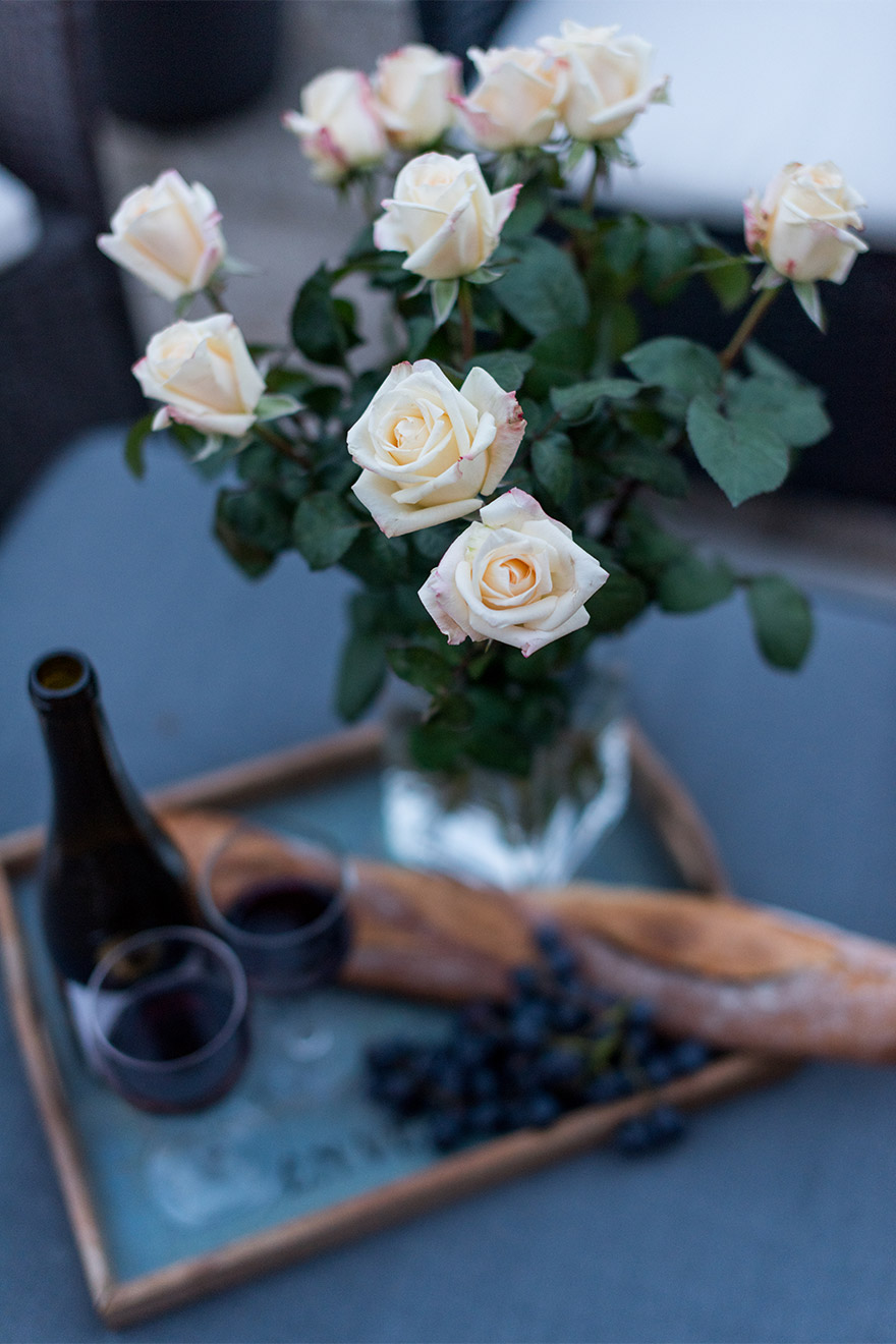 Roses and wine make for a perfect romantic evening at the Margaux vacation rental offered by Paris Perfect