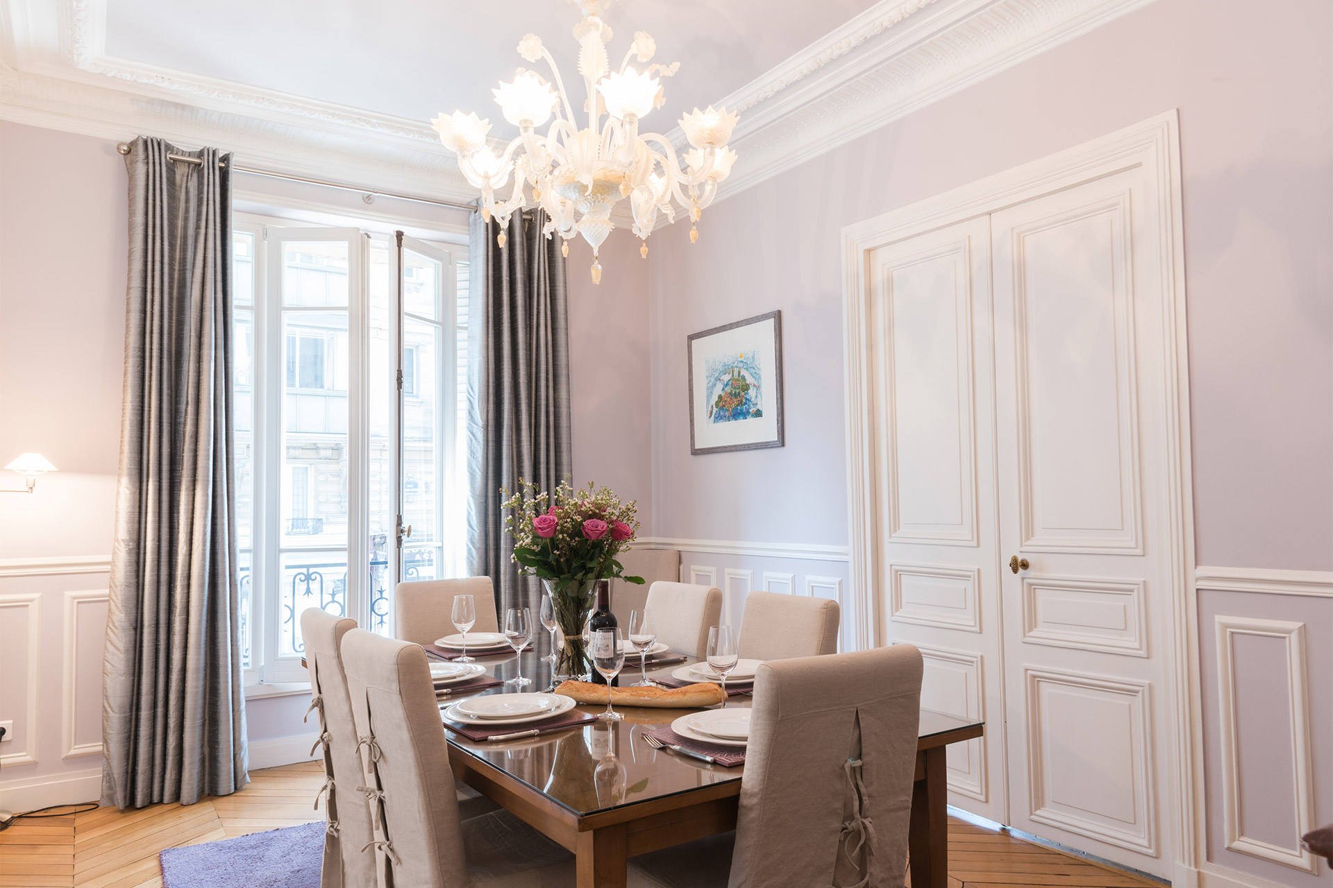 Elegant dining table seats six guests in the Maubert vacation rental offered by Paris Perfect