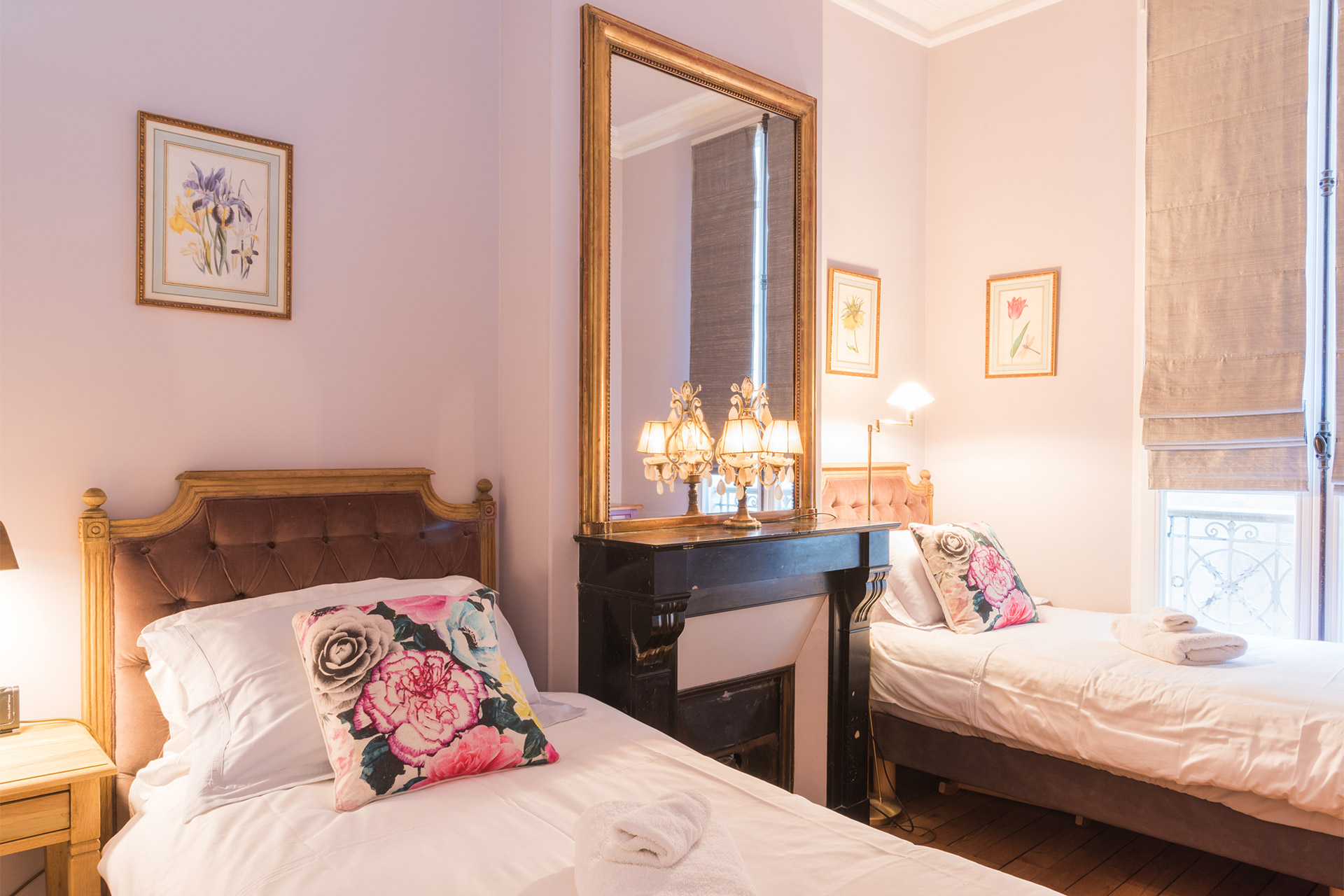 Second bedroom with two single beds in the Maubert vacation rental offered by Paris Perfect