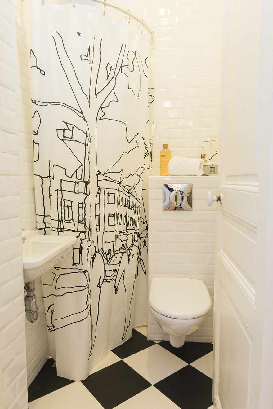 The second bath with small corner shower is perfect for busy mornings in the Maubert vacation rental offered by Paris Perfect