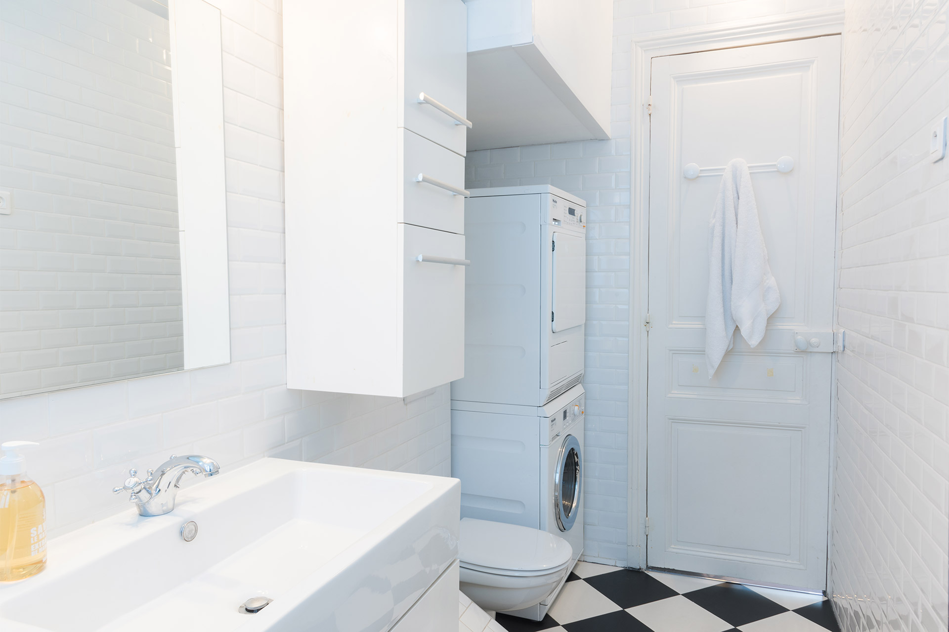 Separate washing machine and dryer in the Maubert vacation rental offered by Paris Perfect