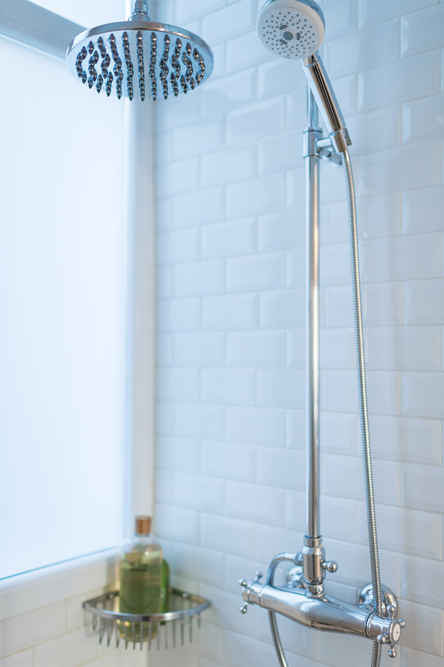 Fixed and flexible shower heads in the Maubert vacation rental offered by Paris Perfect