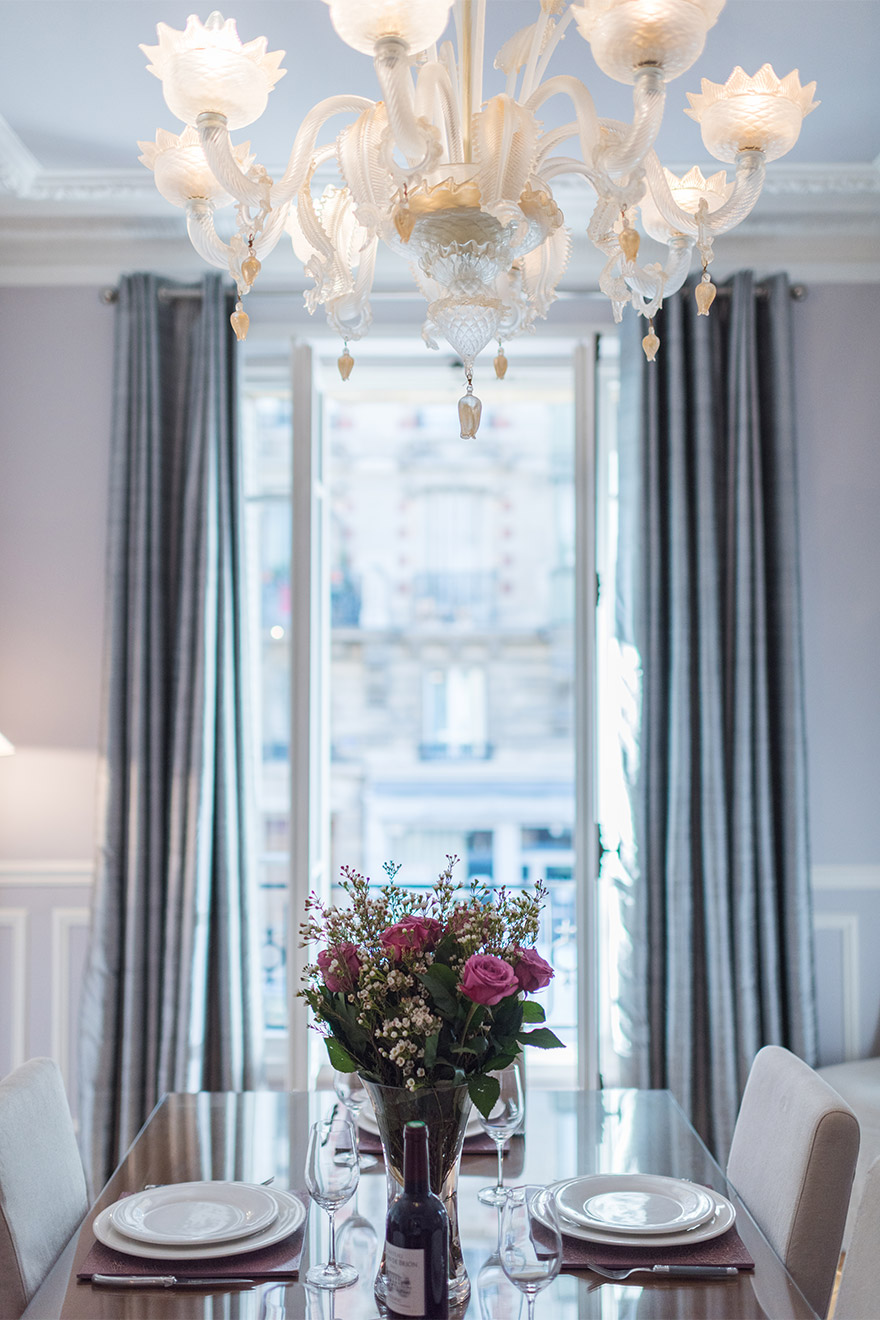 Gaze out of the window during dinner in the Maubert vacation rental offered by Paris Perfect